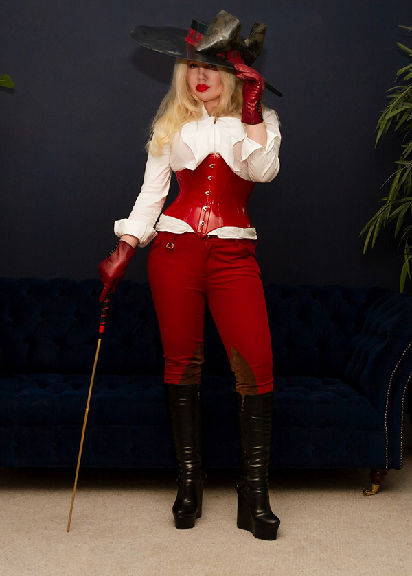Stylish blonde dominant alpha female with cane ready to give discipline